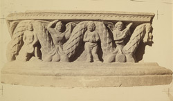 Sculpture slab from the lower monastery at Nutta, Peshawar District: Boys with a garland
